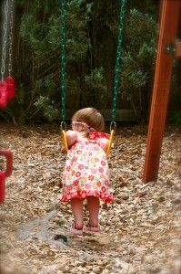Swinging in a pretty new dress.